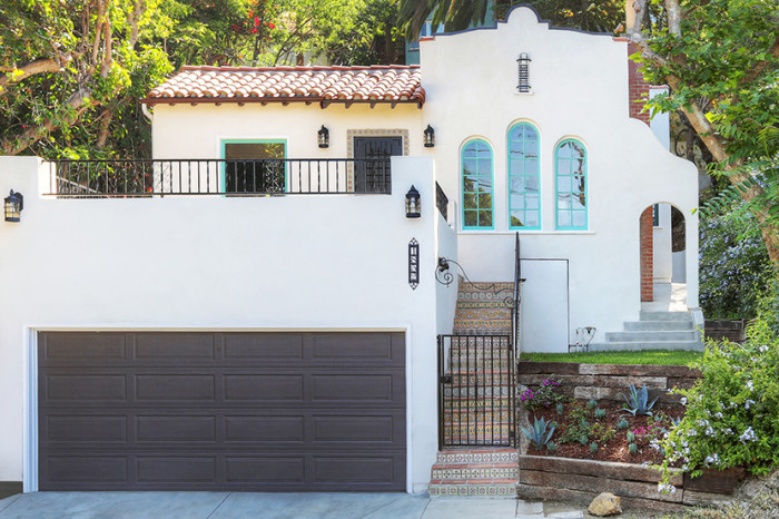 spanish style dream home pops of aqua wrought iron details