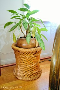 rattan wicker foot stool used as a plant stand
