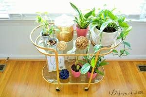 gold vintage bar cart full of lush plants the perfect way to use a bar cart with little kids around!