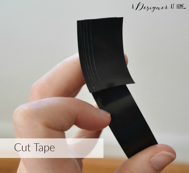 cut strips of electrical tape the same size