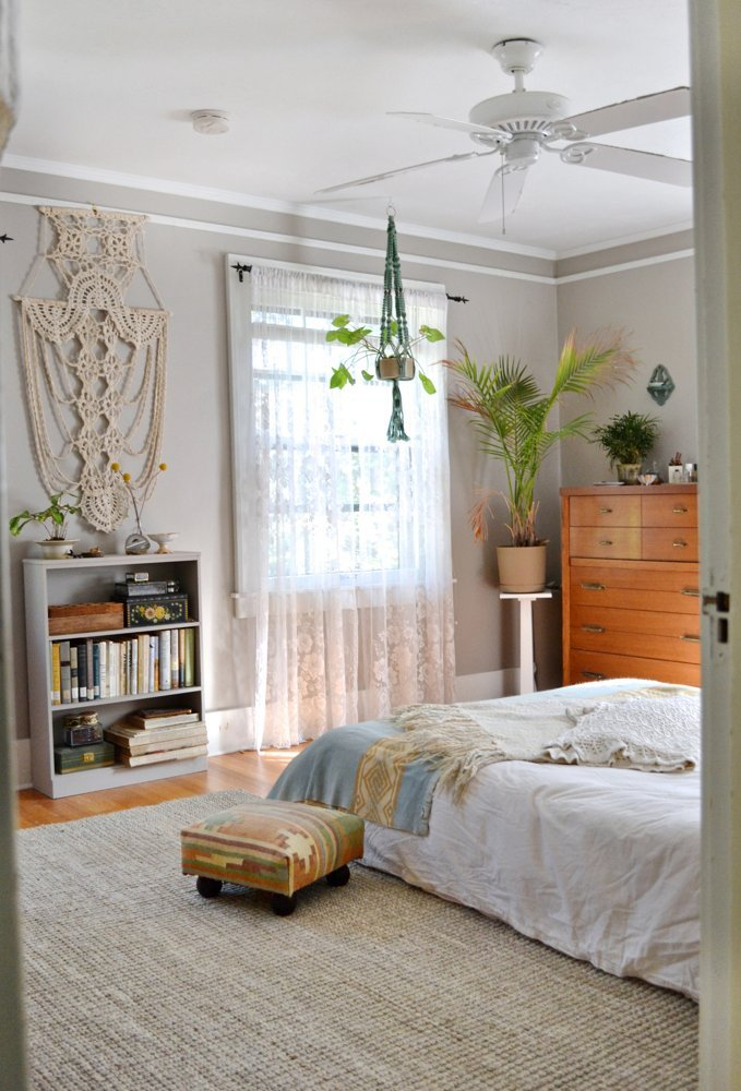 add-height-to-a-shorter-piece-of-furniture-by-hanging-a-large-scale-wall-hanging-above-apartment-therapy