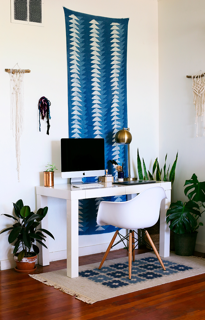 blue-patterned-fabric-wall-hanging-accent-behind-desk
