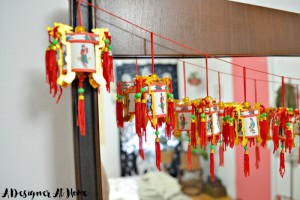 boho-eclectic-mid-century-bedroom-dresser-mirror-garland-chinese-palace-lantern-red-lucky