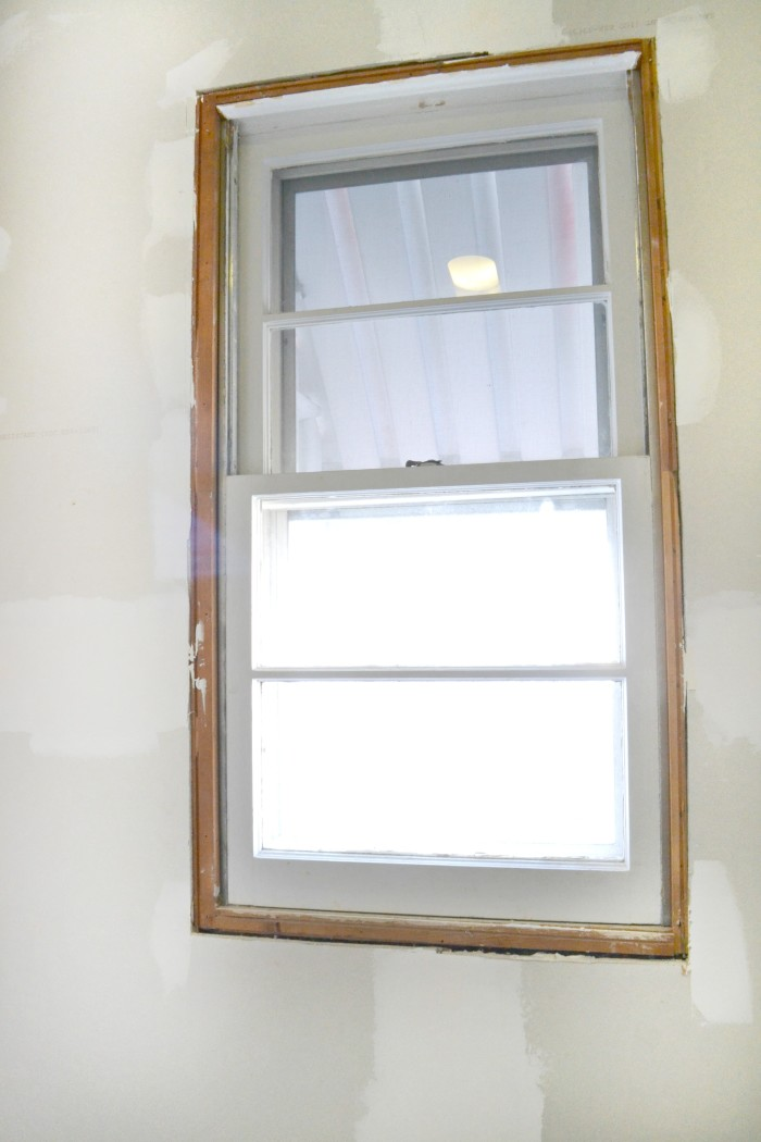 bathroom-window-new-insulation-drywall-waiting-on-trim-bathroom-remodel