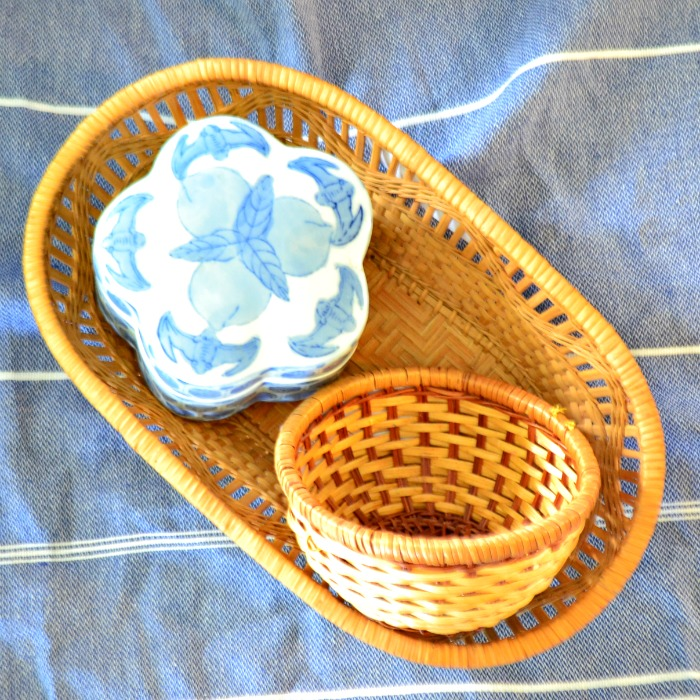 thrifted baskets and containers for a global boho bathroom design