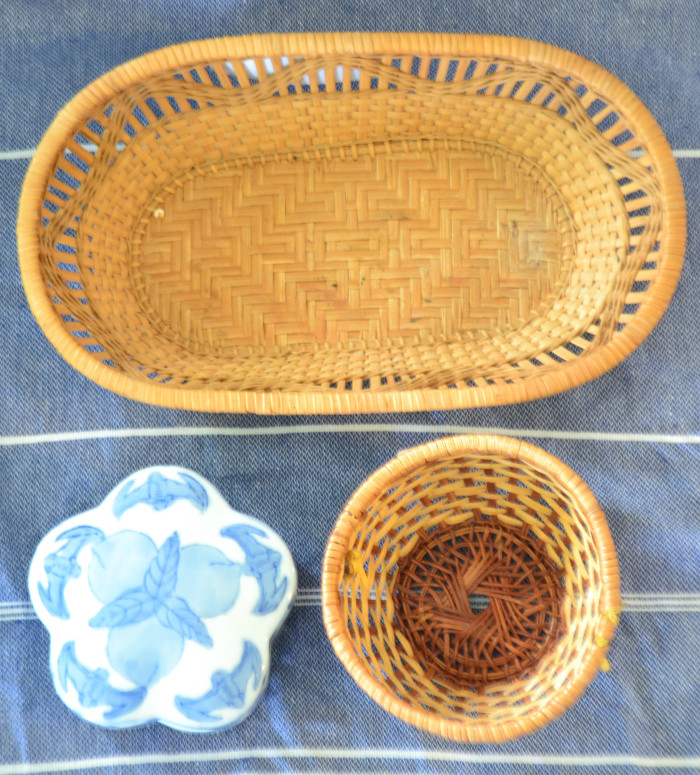 Thrifted baskets and lidded ceramic jar.