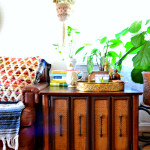 VIntage Cabinet and Vinyl Sofa bohemian decorating family loved living room