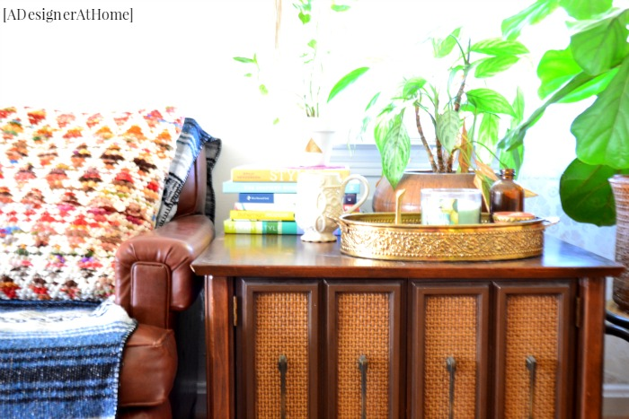 Vintage thrifted end table cabinet styled with bohemian decor