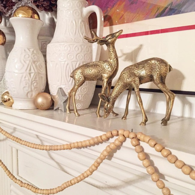 "@maggieoverbystudios Thrift store ornaments totally don't count as buying ""New"" ornaments because technically they are old ornaments. Scored these brass deer, wooden bead garlands, and about 50 gold and white ornaments for $9 not feeling guilty at all! #thriftscorethursday #christmasdecor #brassdeer #colddeadfingers #bloggingyourway #finditstyleit #jmholidaystyle #completehappyhome#westgermanpottery"