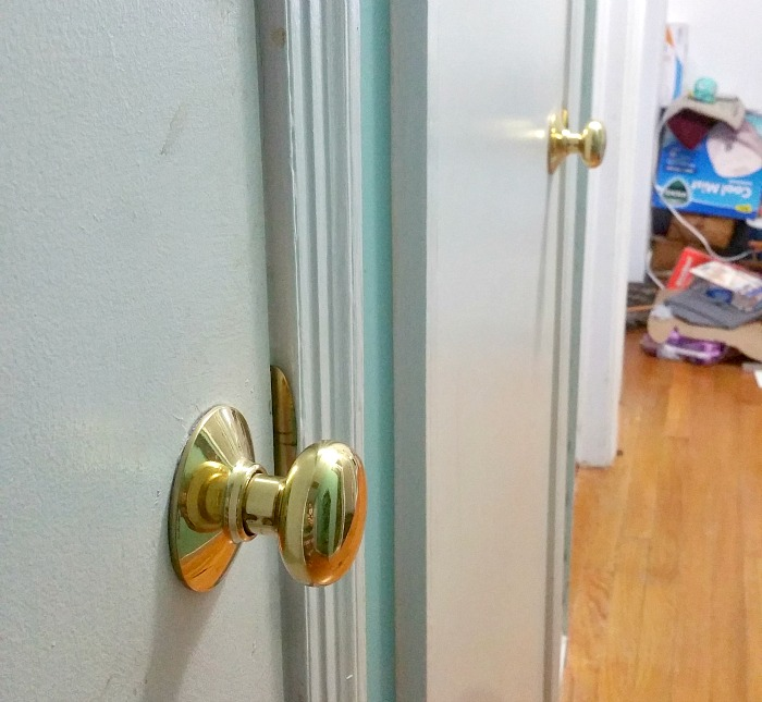 ugly hallway full of polished brass door knobs