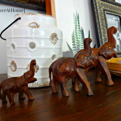 vintage wooden elephants and a lantern