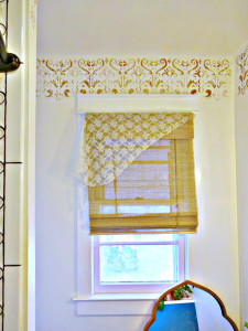 layered window treatments with a copper indian stencil border
