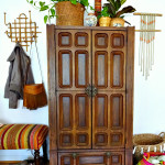 Home office in a cabinet. Ornate wooden cabinet holds craft, DIY and office supplies