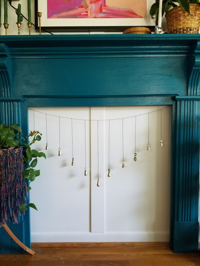 DIY home decorating adding missing character like teal fireplace, wainscoting and bell charm