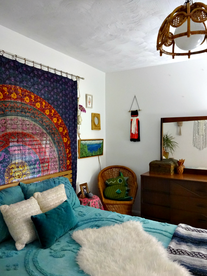 Lots of texture and pattern and color in this bedroom