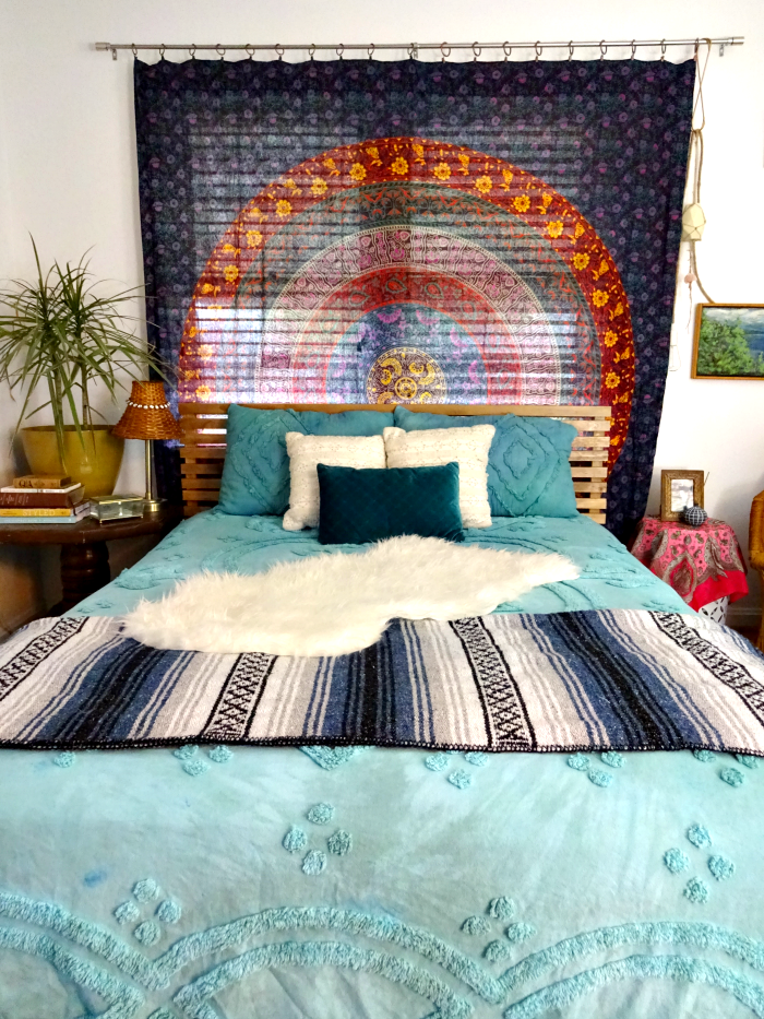 bohemian bedroom with tapestry curtain and headboard, hand dyed bedding, multi textures