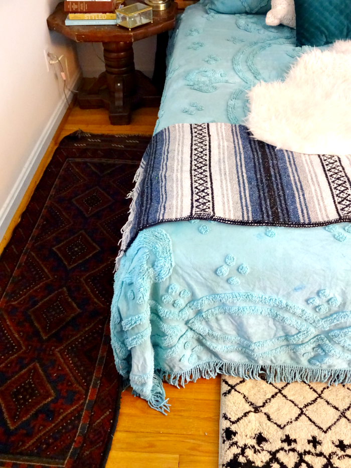 multiple rugs and textiles layers