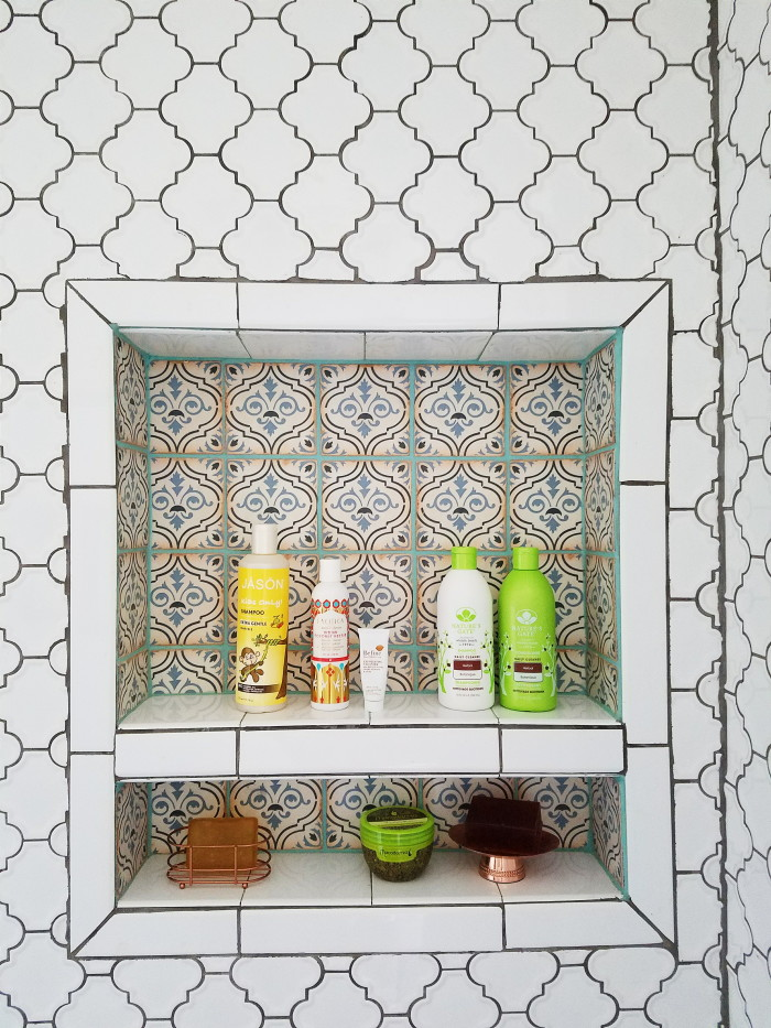Bohemian bathroom inspiration. White tike, blue, green, copper and bronze. Moroccan inspired tile floor to ceiling.