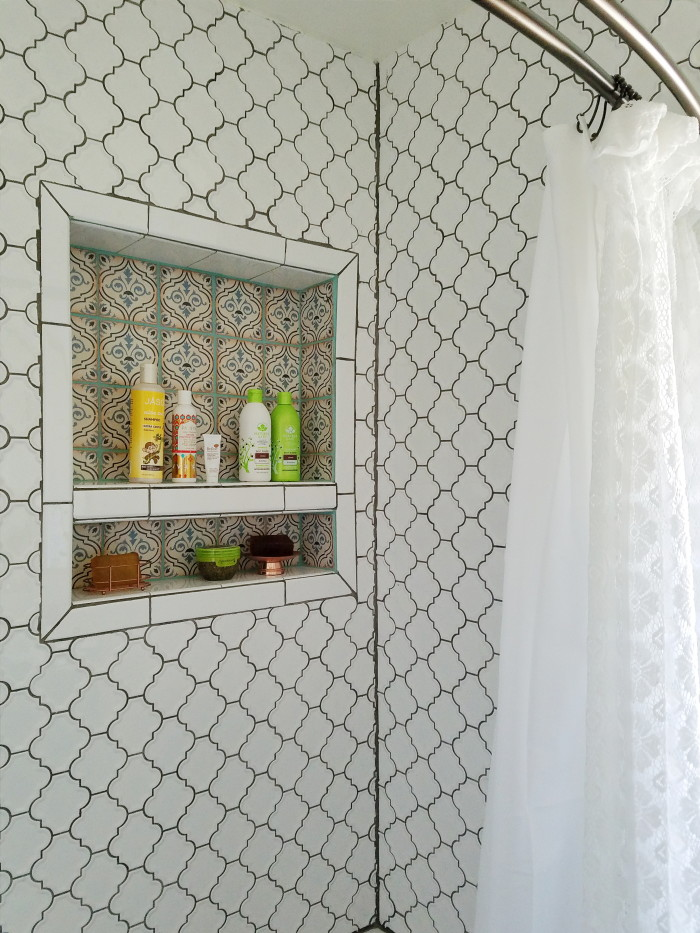Global inspired bohemian bathroom white tile copper border