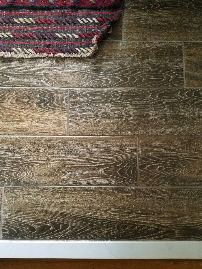 Inexpensive wood look tile with vintage rug