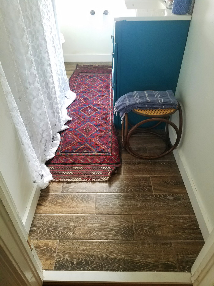 The floors in my vintage bohemian bathroom