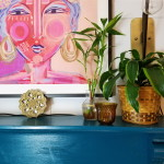 Blue Fireplace Mantle with plants and warm golden tones
