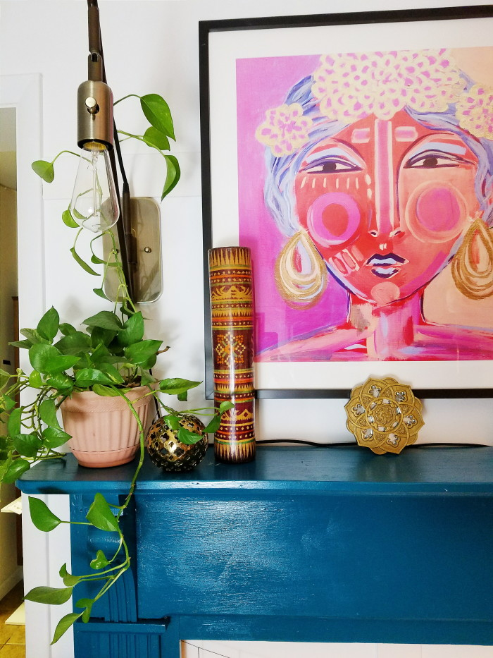 Colorful, bohemian fireplace mantle decorating