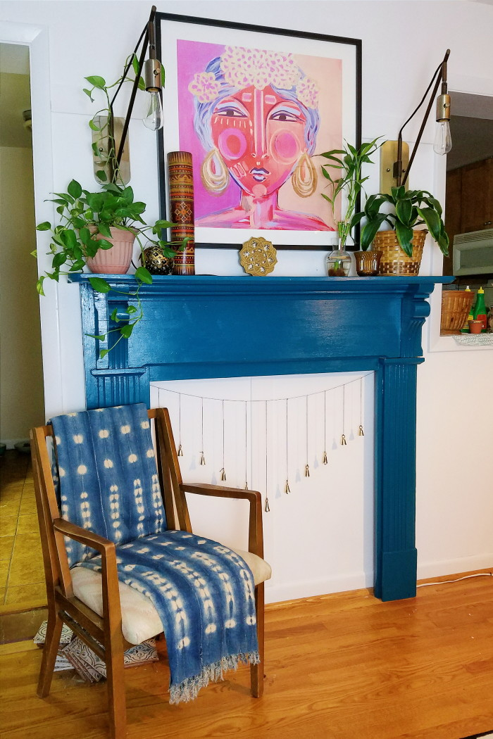 Bohemian fireplace mantle. Blue painted mantle. Plants, vintage finds and funky art.