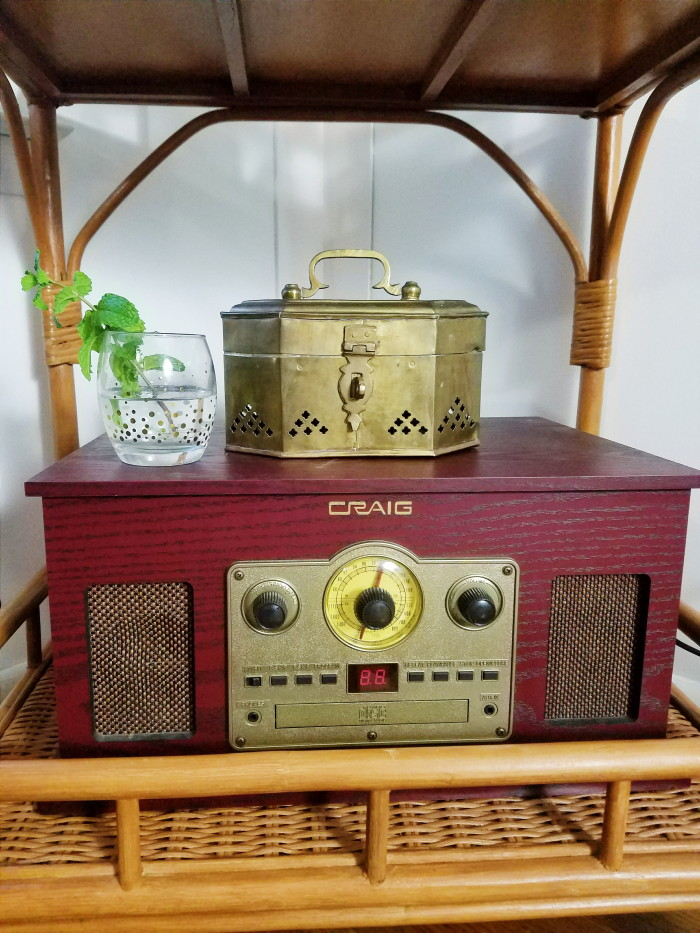 Brass trunk on vintage inspired stereo