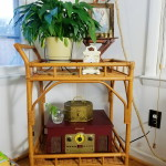 Rattan bar cart decorated with vintage bohemian finds