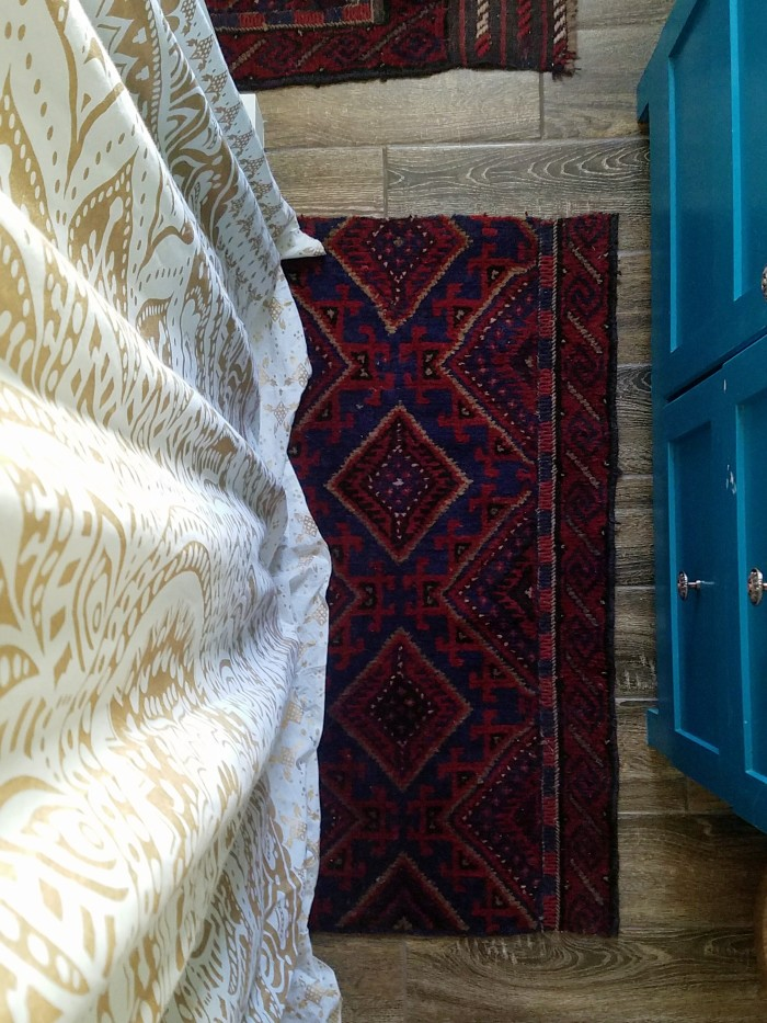 Cutting a vintage rug into bath rug shapes for a unique one of a kind boho look