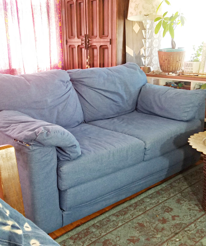 generic hand me down ugly sofa boho-ified with items around the house