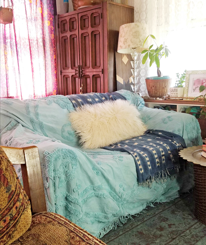 Old Sofa Covered In Turquoise Hand Dyed Bed Coverlet With Indigo Mudcloth  And Mongolian Fur Pillow
