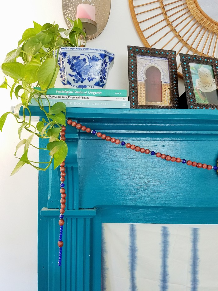 Blue fireplace mantle wood and blue bead bohemian garland mantle styling