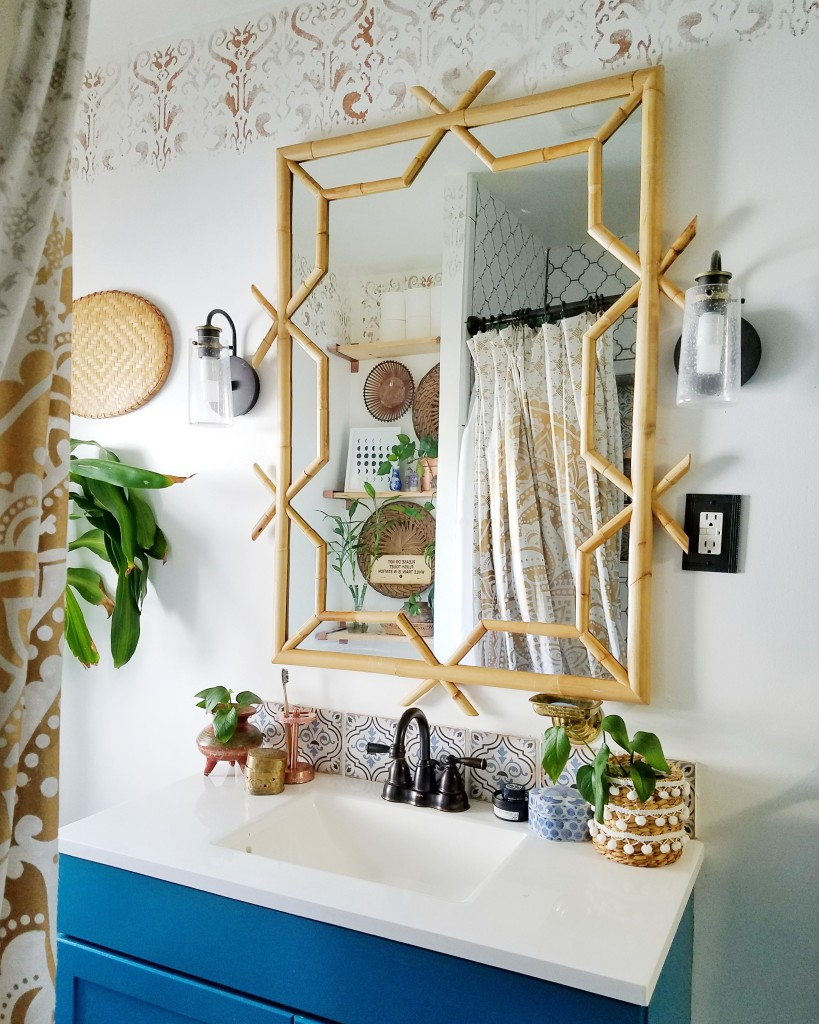 Global boho bathroom, rattan mirror, blue vanity