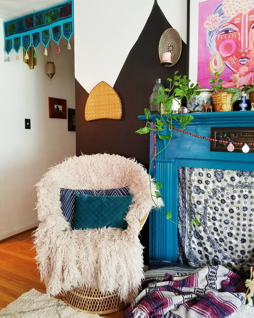 living room boho hallway fur covered chair and fireplace