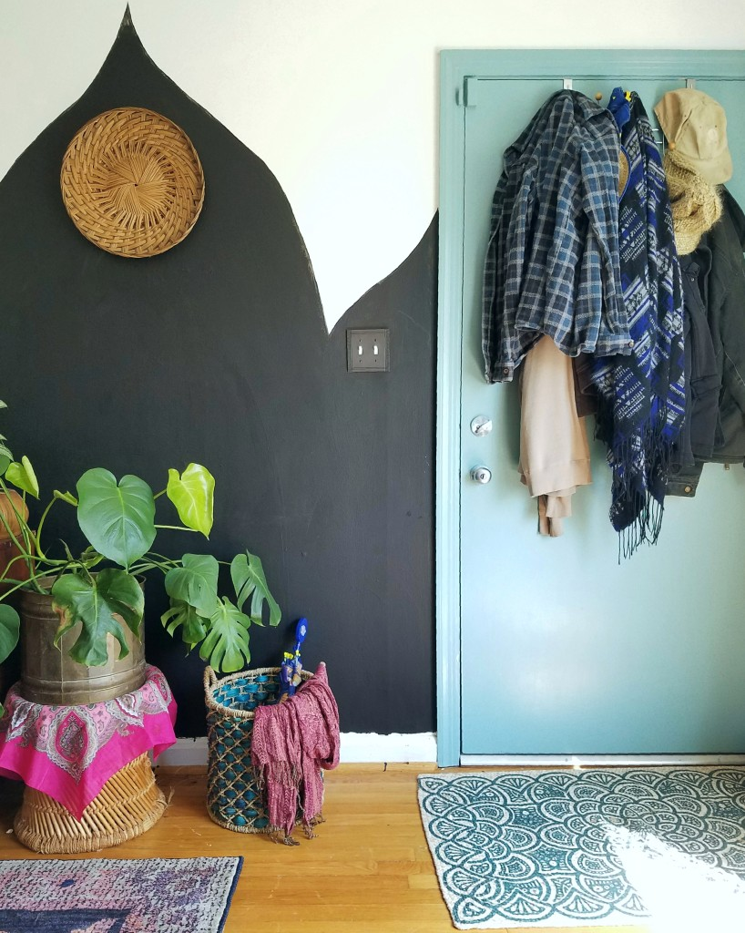 Small or no entry way solution: Use a basket to gather gloves, scarves and umbrellas