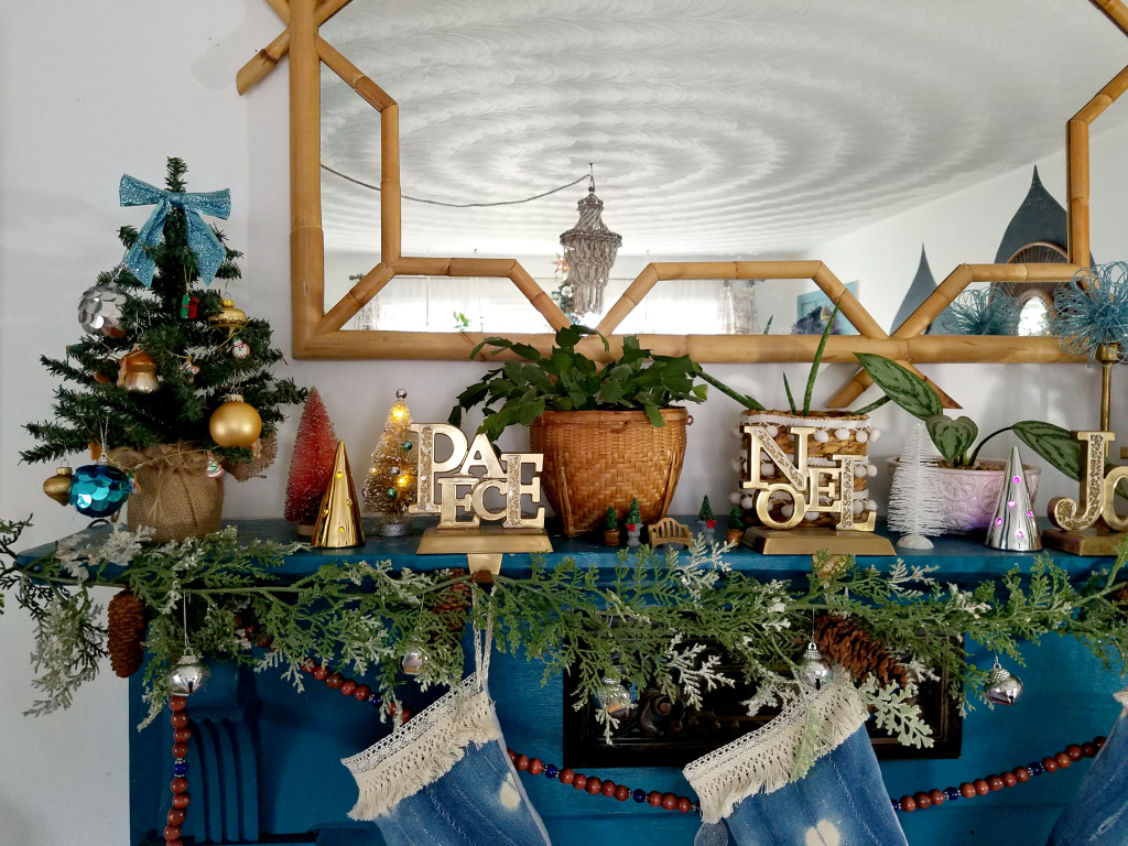colorful-eclectic-christmas-mantel-decorated-with-live-houseplants