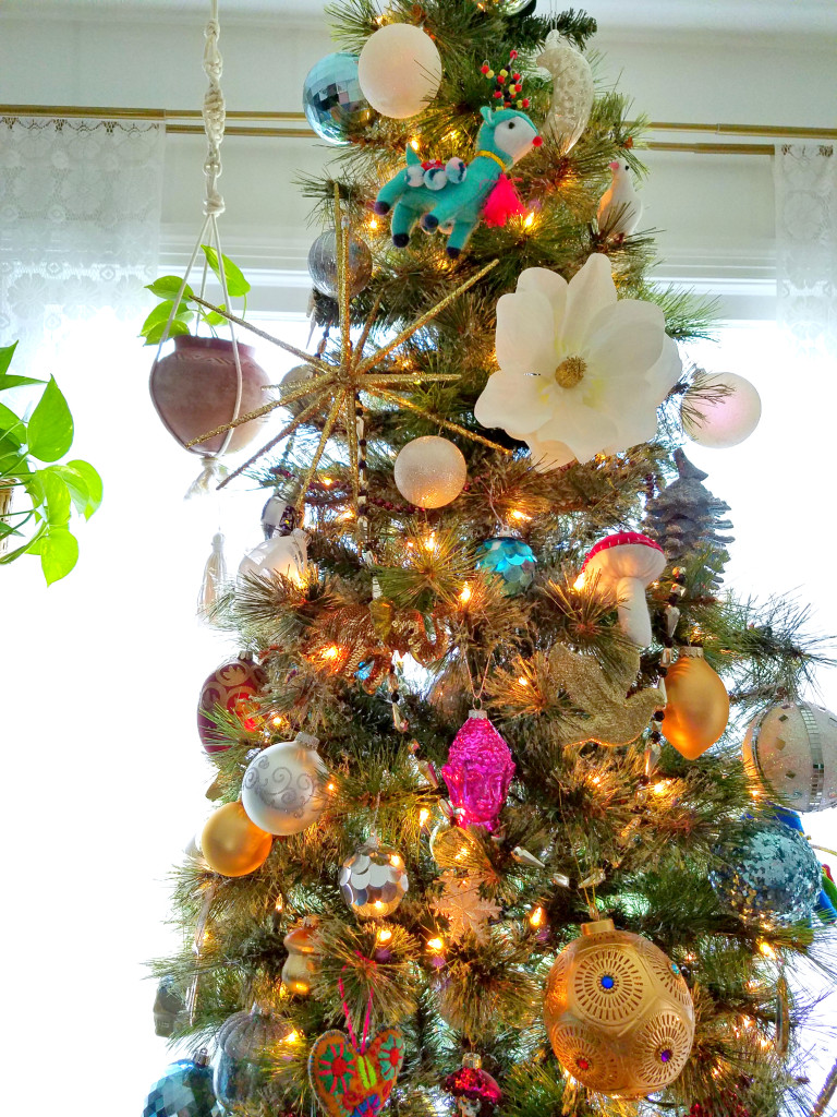 Global Boho Christmas Tree incorporates bright pops of color with whimsical mushroom, bird and flower ornaments