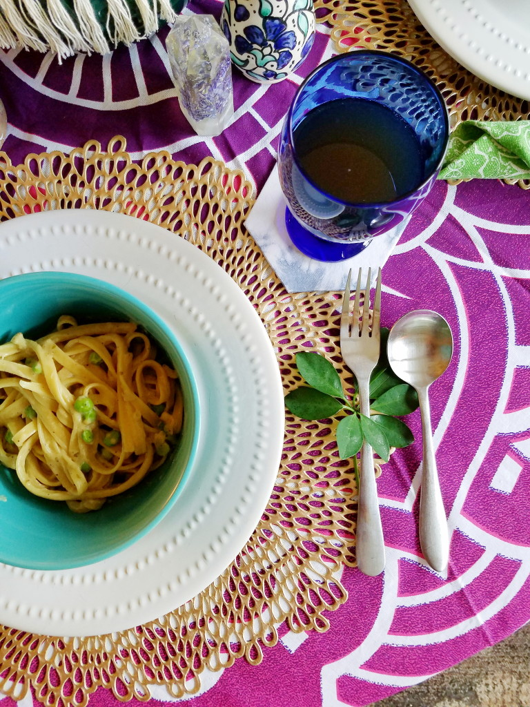 Vegan friendly fettuccine Alfredo spring table setting
