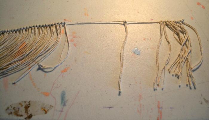 larks-head-knot-the-smaller-strings-onto-the-longer-string