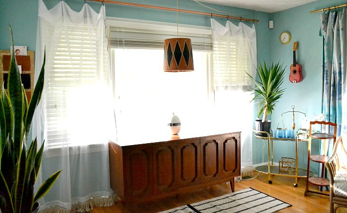 sheer-sequin-and-fringe-accented-curtains-flank-credenza (1)
